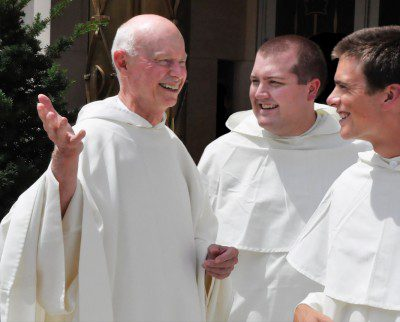 Father Kenneth Letoile, O.P. talking with two novices, Brother Ezra Fegley and Brother Philip Nolan.