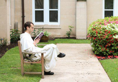 Br. Bonaventure Chapman, O.P. reads in the Cloister Garden at the Dominican House of Studies.
